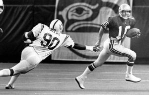 Zorn puts his scrambling prowess on display in a game against the Baltimore Colts in the Seattle Kingdome.